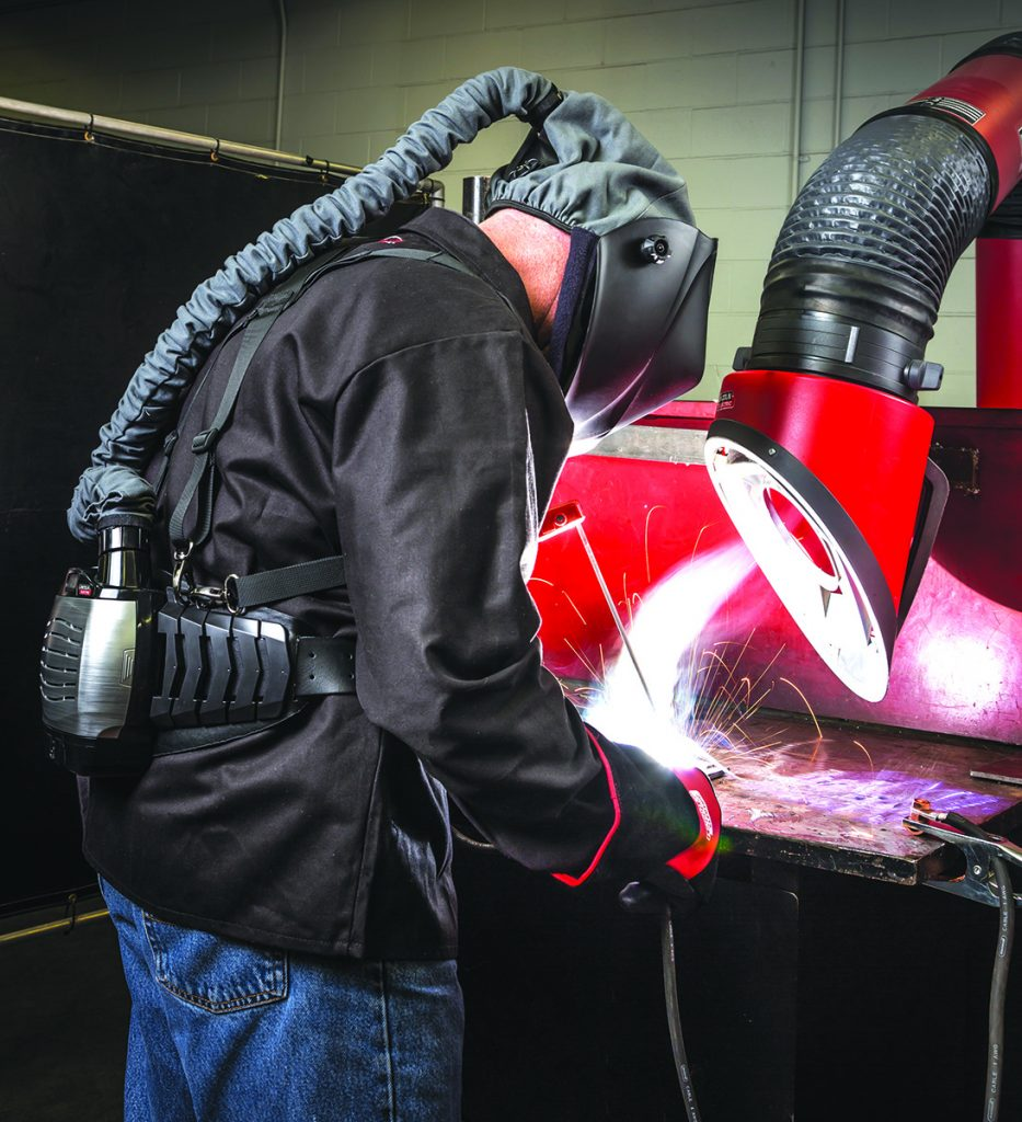 Stick welder using Viking PAPR (Powered Air Purifying Respirator) Helmet and Mobiflex 200-M welding fume extraction unit.